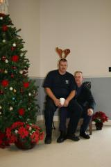 Two fire captains keeping Santa's chair warm
